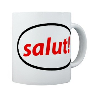 A cup showing the French word 'Salut' which translates in Hello in English